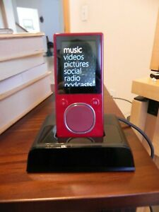 Microsoft Zune Red 8GB Digital Media Player and docking station.  Needs battery.