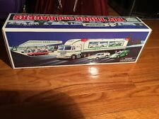 VINTAGE HESS GASOLINE TOY 18 WHEELER TRUCK AND RACER NOS IN ORIGINAL BOX 1997