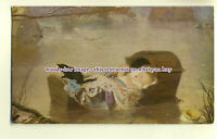 an0146 - Black Kitten on Babies Cradle in Water, (maybe Moses??)  - postcard