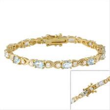 18k Gold over Silver Blue Topaz X & O Tennis Bracelet