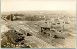 1910s SYRACUSE, Kansas RPPC Real Photo Postcard Bird's-Eye Town View / Rail Cars