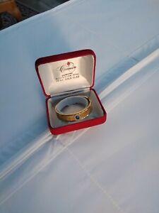 carmen 22ct gold plated bangle Australian opal, 6cm. diameter stamped 22ct HGP