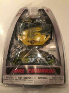 CARL EDWARDS 2010 AFLAC 1/64 WINNERS CIRCLE DIECAST WITH SCHEDULE HOOD