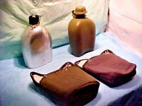 2 -  Canteens And Covers with Belt Clip Holsters - 1 metal and 1 plastic canteen