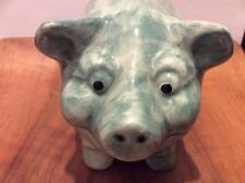 A lovely green piggy bank by Dartmouth Pottery, England from 1995
