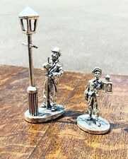 More details for silver plate figures. lamp lighters, highly detailed figures.