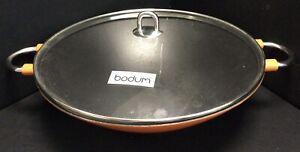 Bodum Chambord Cast Iron Wok With Orange Enamel Coating