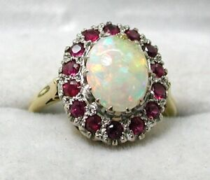Beautiful 18 carat Gold Large Opal And Ruby Dress Ring Size N.1/2