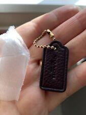 Dark burgundy small Coach bag tag.Leather.New
