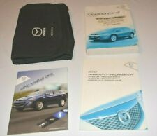 2010 MAZDA CX9 OWNERS MANUAL GUIDE BOOK SET WITH CASE OEM
