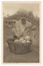 A COCONUT SELLER PEDDLES HIS WARES IN INDIA (VINTAGE REAL PHOTO POSTCARD)