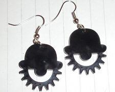 Black retro clockwork orange logo charm earrings kitsch Halloween