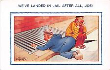 Bamforth Comic postcard drinking humor drunk men sidewalk grate Landed in Jail
