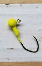 100ct. 1/8oz Chartreuse jig head with #1 bronze Eagle Claw Lil' Nasty hook