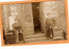 Real Photo Postcard RPPC - Two Men and Exterior of Stove and Furniture Store
