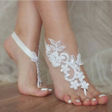 Pair of white lace/sequin foot sandals