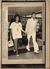 elizabeth taylor & richard burton. old ap wire photo ( at heathrow )