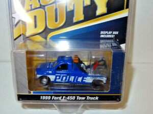 JOHNNY LIGHTNING ACTIVE DUTY POLICE 1999 FORD F-450 TOW TRUCK WRECKER