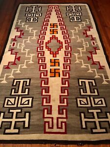 LARGE 1920s NAVAJO CRYSTAL TRADING POST RUG W/ DRAMATIC WHIRLING LOGS, EXCELLENT