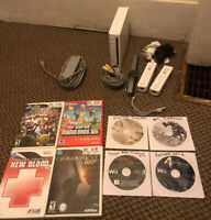 Nintendo Wii Bundle INCLUDES 8 GAMES, 2 Remotes, 2 Nunchuks, Mario, Super Smash