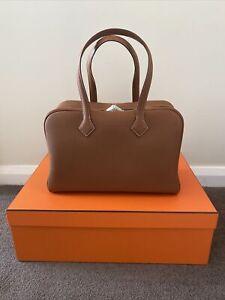 Brand New Hermès Bag Victoria II fourre-tout 35 bag Taurillon Clemence Gold