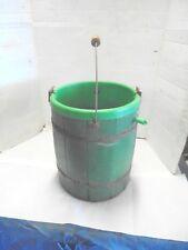 small green barrel from ice cream maker plastic insert flower planter garden