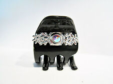 Small mini black hair claw clip with detailed metal and crystal