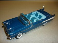 A 1/24th Scale Franklin mint model of a 1957 Chevrolet Bel-air convertible