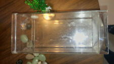 Plastic Self cleaning fish tank- stones, and fake plant included.