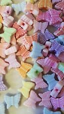 50pcs x 8mm resin pastel butterfly beads. Can also be used as an embellishment.