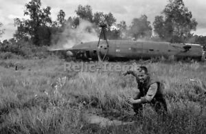 Vietnam War Photo Picture US crewman runs from a crashed CH-21 Shawnee 0552