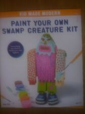 Kid made modern.Paint your own swamp Creature kit