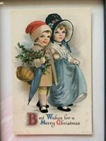 ANTIQUE CHRISTMAS POSTCARD SHOWING YOUNG COUPLE AT CHRISTMAS