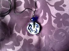 A blue and white ceramic necklace