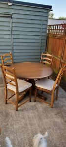 Ercol extending round dining table and chairs - excellent condition