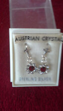 SILVER EARINGS. AUSTRIAN CRYSTAL CLEAR AND RED CENTRE STONE