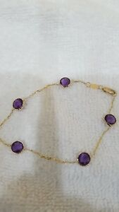 14k Yellow Gold Bracelet 7+ with Amethyst 6mm round checkabord both side. Lobste