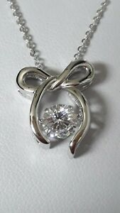 925 STERLING SILVER RHODIUM PLATED BOW MOVING STONE PENDANT NECKLACE