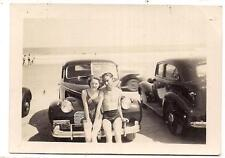 Swimsuit Couple Sitting On Front Bumper Of Vintage Car At Beach 1940s Photo