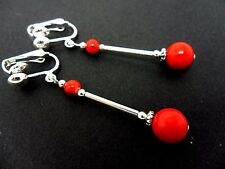 A PAIR OF DANGLY RED CORAL BEAD  SILVER PLATED DROP CLIP ON EARRINGS.