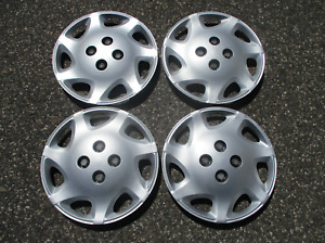 Factory 2000 to 2002 Saturn S series bolt on 14 inch hubcaps wheel covers