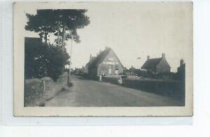 Real photo postcard of a village shop at Ducklington Oxfordshire good condition