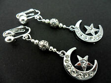 A PAIR STAINLESS STEEL DANGLY MOON & STAR DIAMANTE CRYSTAL CLIP ON EARRINGS. NEW