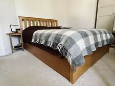 Oak double bed frame with storage
