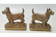 A pair of early 20th Century brass bookends