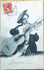 1907 Music Postcard: A Young Woman Tuning a Guitar, Hat