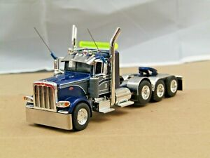 Dcp Custom blue/gray Peterbilt 389 daycab 4 axle heavyhaul tractor 1/64