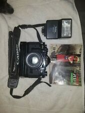 Canon A-1 35mm SLR Film Camera with 50 mm lens w/auto-advance motor and Flash