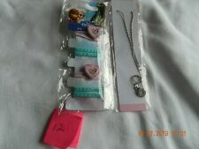 frozen hair bobbles pack of 4 and a silver looking necklace