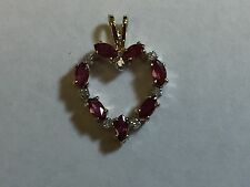 0.75 CTW RUBY and 0.11 CTW DIAMOND HEART PENDANT - SET IN 14K YELLOW GOLD